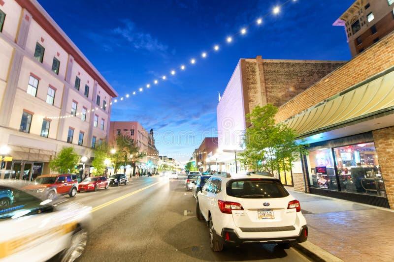 SAVANNAH, GA - APRIL 2, 2018: Tourists enjoy city streets at night. Savannah hosts 15 million tourists annually stock photos