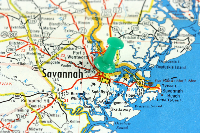 Savannah, Georgia. Savannah in Georgia, USA. Push pin on an old map showing travel destination. Selective focus stock photos