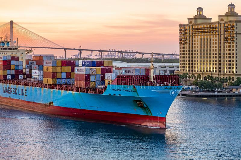 Maersk Line on Savannah River. SAVANNAH, GEORGIA - April 29, 2019:  Freighters now carry most of the world`s cargo and the largest container ships can carry over stock image