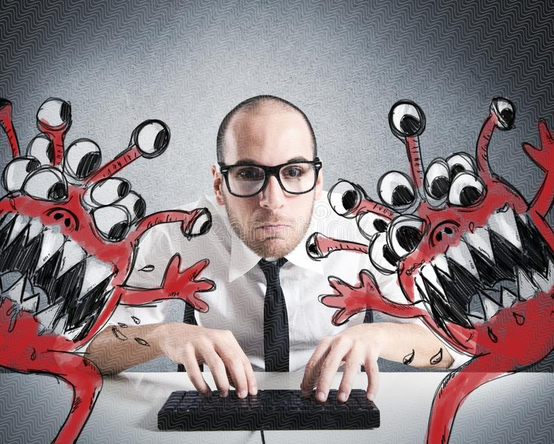 Save the computer. Businessman attempts to eradicate computer from viruses stock photo