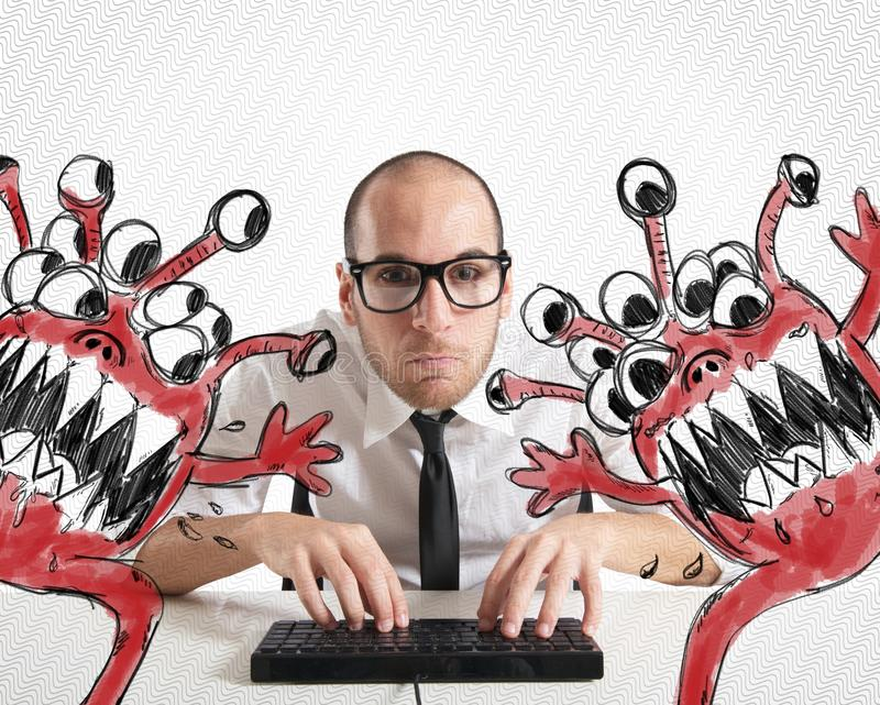 Save the computer. Businessman attempts to eradicate computer from viruses stock photography