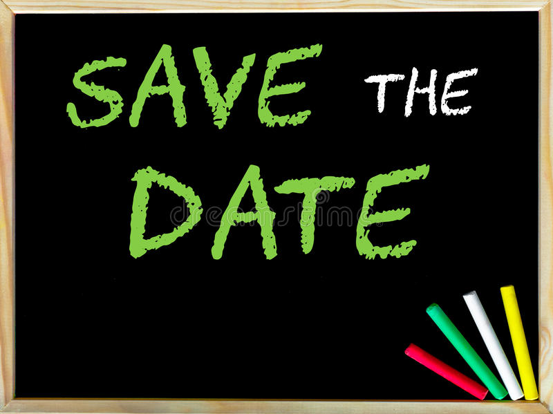 Save the Date. Message.Handwriting with chalk on wooden frame blackboard, colored chalk in the corner. Concept image royalty free stock photos