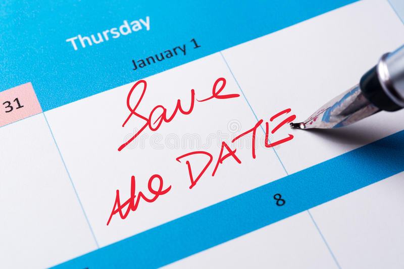 Save the date. Words written on calendar using pen royalty free stock photos