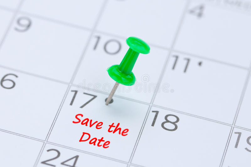 Save the Date written on a calendar with a green push pin to rem. Ind you and important appointment stock photos