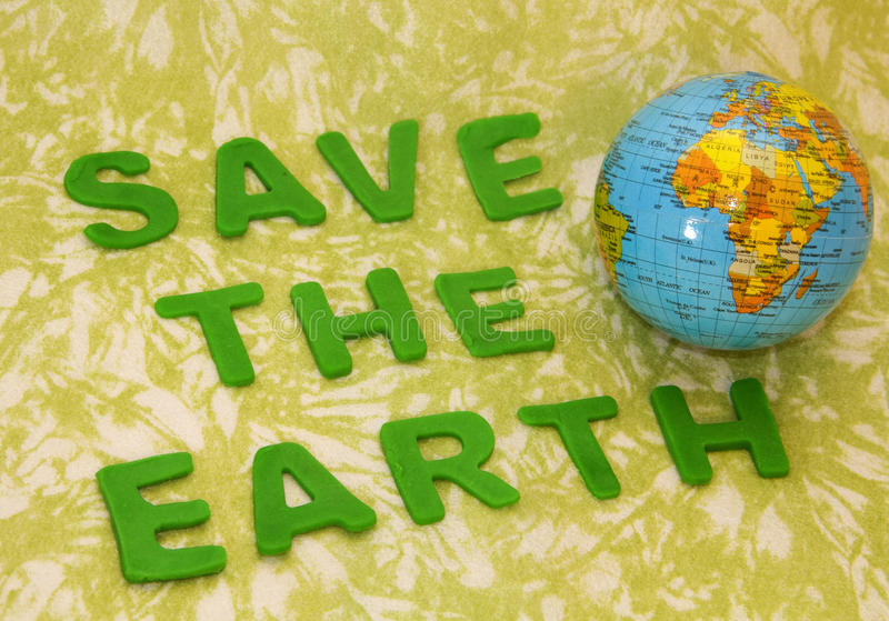 Save the earth. Sentence that says save the earth from pollution stock photo