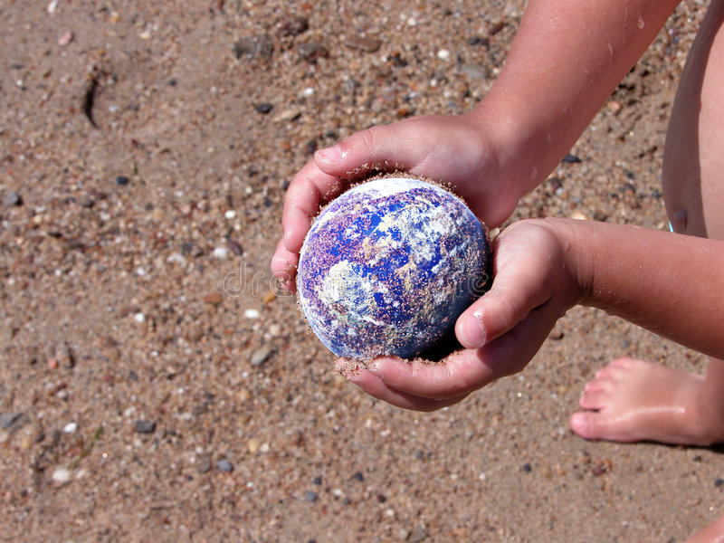 Save the Earth. Computer generated Earth protected by child hands. Concept suitable for environment protection themes. Hands and planet sharp, rest is thrown out