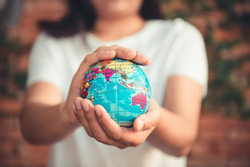 Save The Earth and Care Environment Concept, Close-up Portrait of Woman is Holding Mockup Global in Her Hands on Tree Leave stock images
