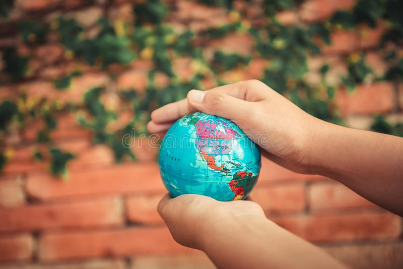 Save The Earth and Care Environment Concept, Close-up Portrait of Woman is Holding Mockup Global in Her Hands on Tree Leave royalty free stock images