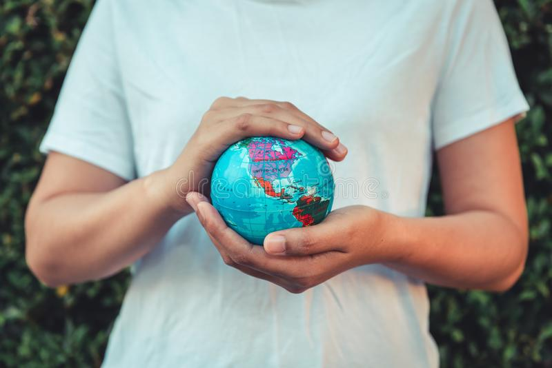 Save The Earth and Care Environment Concept, Close-up Portrait of Woman is Holding Mockup Global in Her Hands on Tree Leave royalty free stock photo