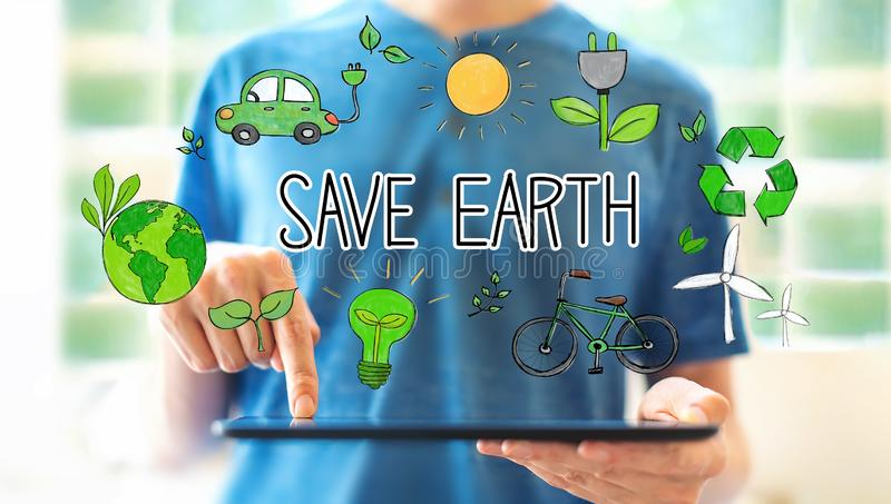 Save earth concept with man using a tablet royalty free stock photography