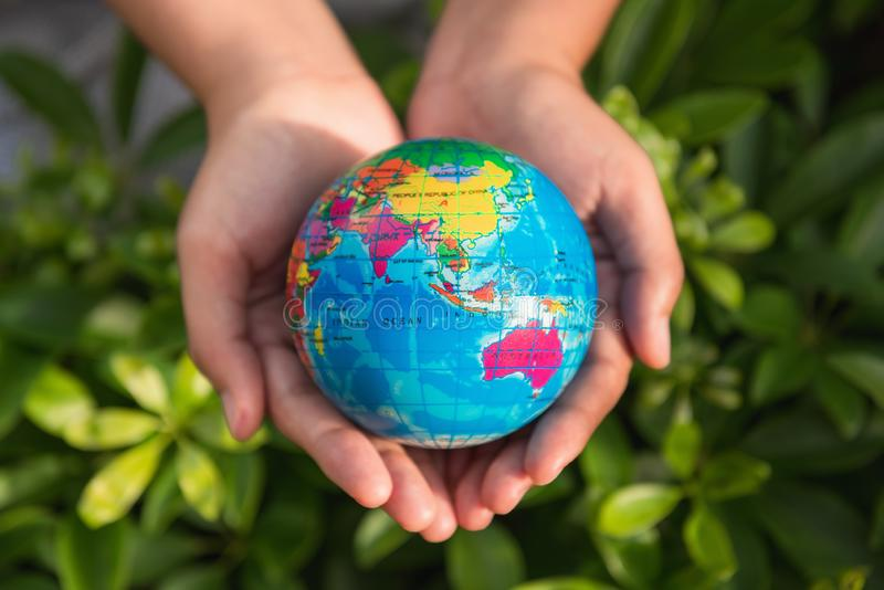 Save the earth concept, Woman hands is holding mockup the global royalty free stock photography