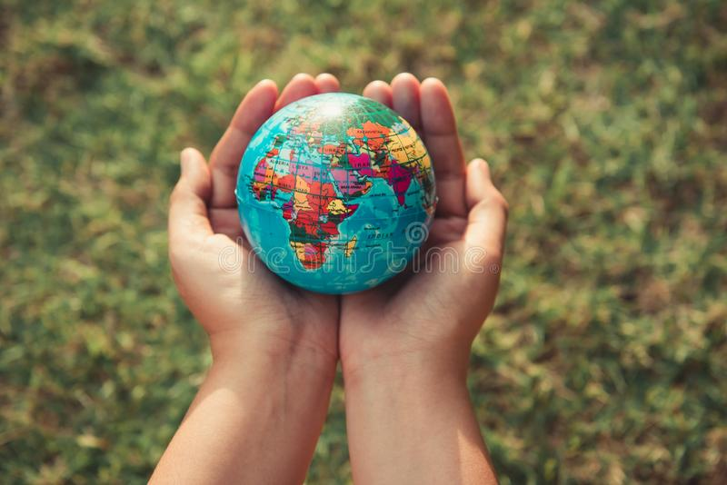 Save the earth concept, Woman hands is holding mockup the global stock photos