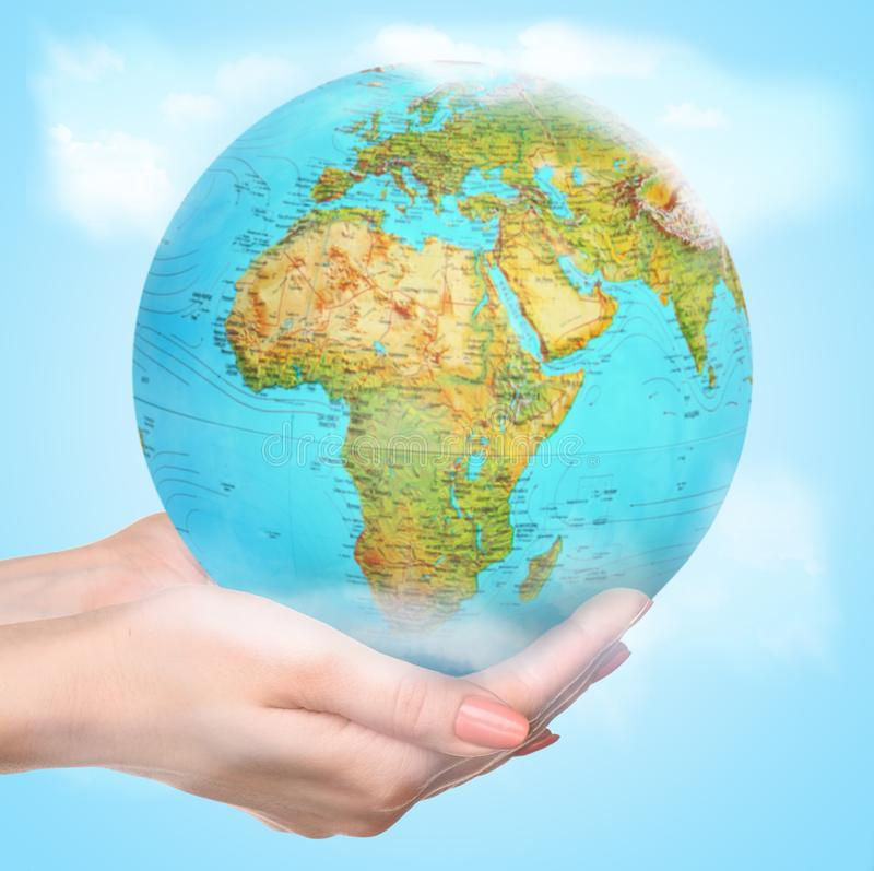 Save the Earth - female hands caressly holding a globe royalty free stock image