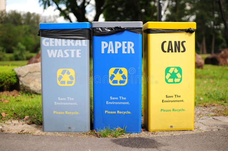 Save the earth, recycle. Different bins for different recycling purposes, save the earth stock images