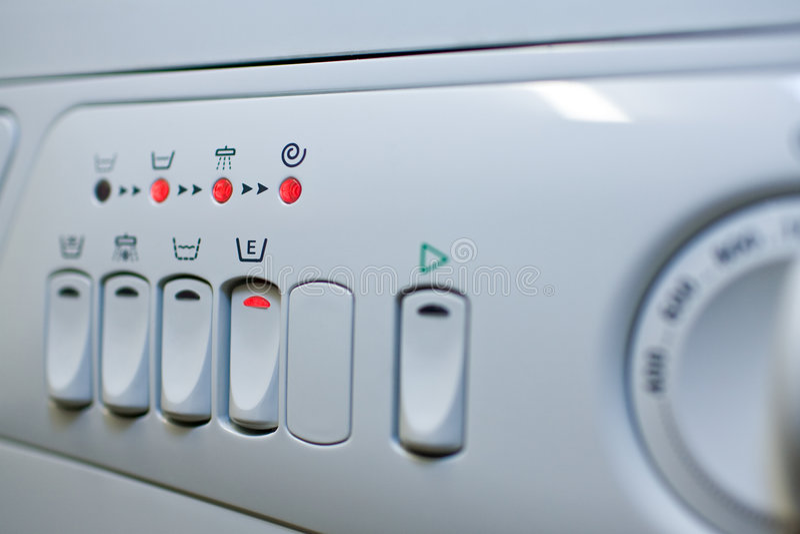 Save energy. Close-up panel white washing machine. Low DOF. Focus button to set the energy-saving royalty free stock photo