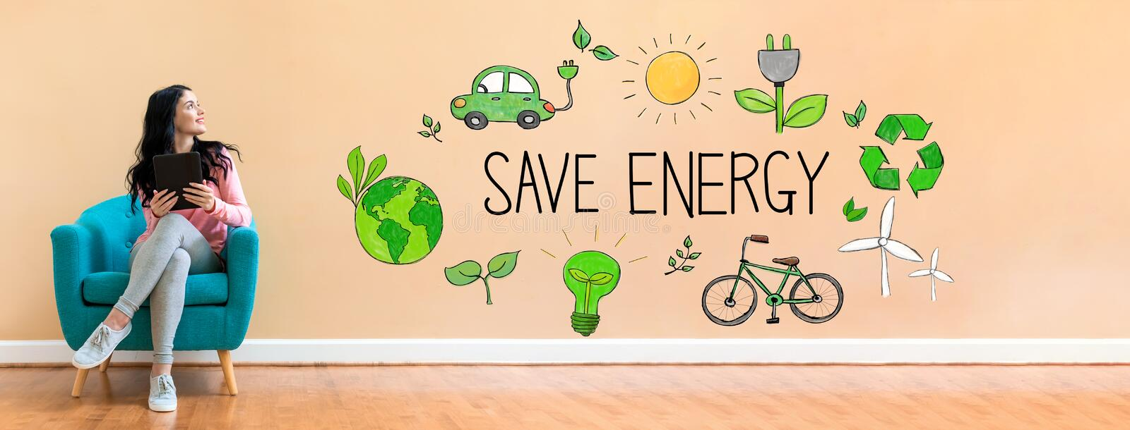 Save energy concept with woman using a tablet stock images