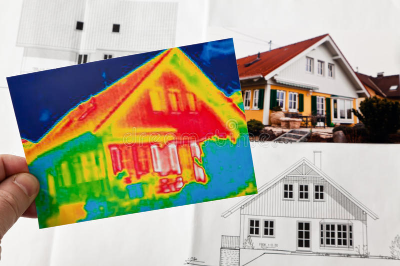Save energy. house with thermal imaging camera stock photography
