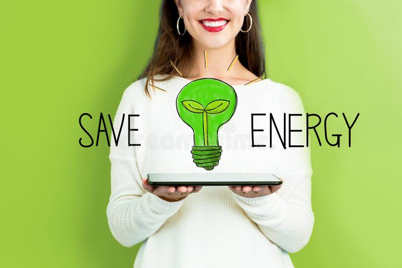 Save Energy with woman holding a tablet stock images