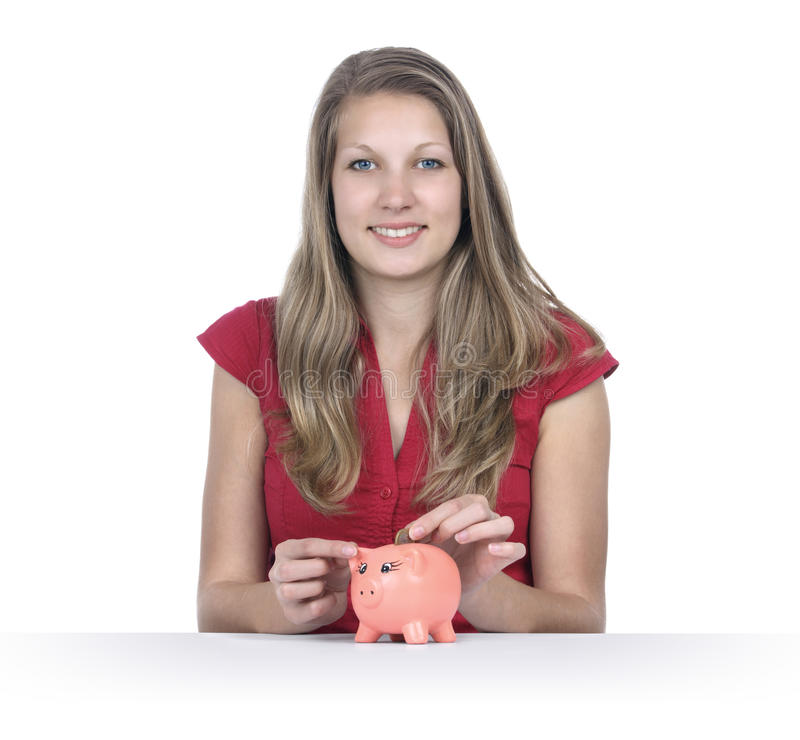 Save money. Concept - beautiful woman hit Euro coin in piggy bank royalty free stock photo