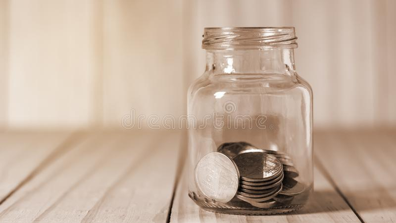 Save money and account banking for finance business concept. Coin in bottle on blurred background royalty free stock photos