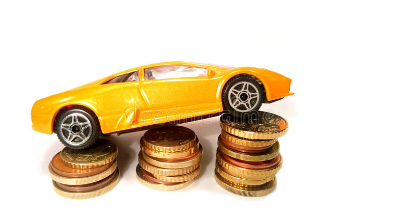 Save money for car. Expansive car on coins. Save money for car stock image