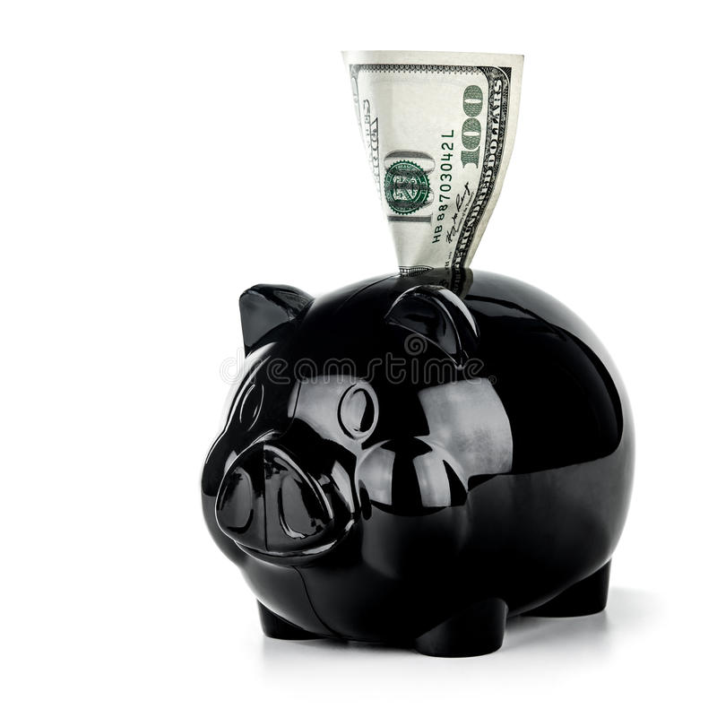 Save money concept. Little black piggy bank with one hundred dollar bill isolated on white background, financial investment, save money concept royalty free stock photography