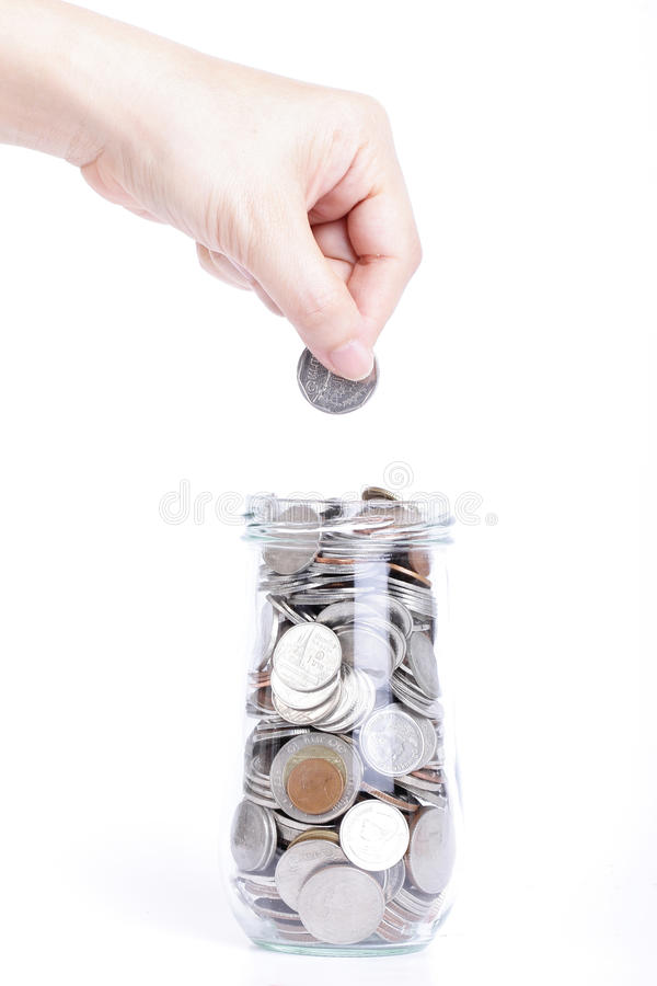 Save money. With female use hand putting a coin to clean glass for deposit to the future stock image