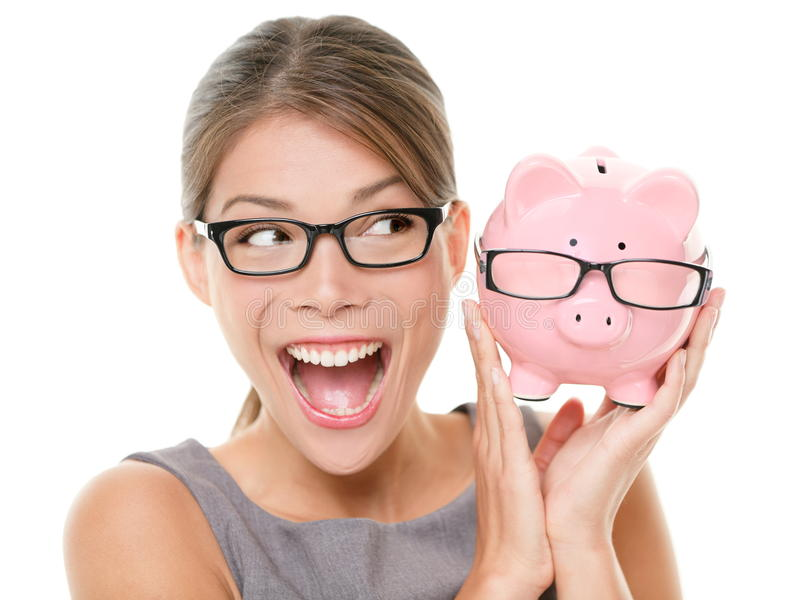 Save money on glasses eyewear. Woman happy and excited over savings on buying eyewear glasses. Piggybank and woman wearing glasses isolated on white background royalty free stock images