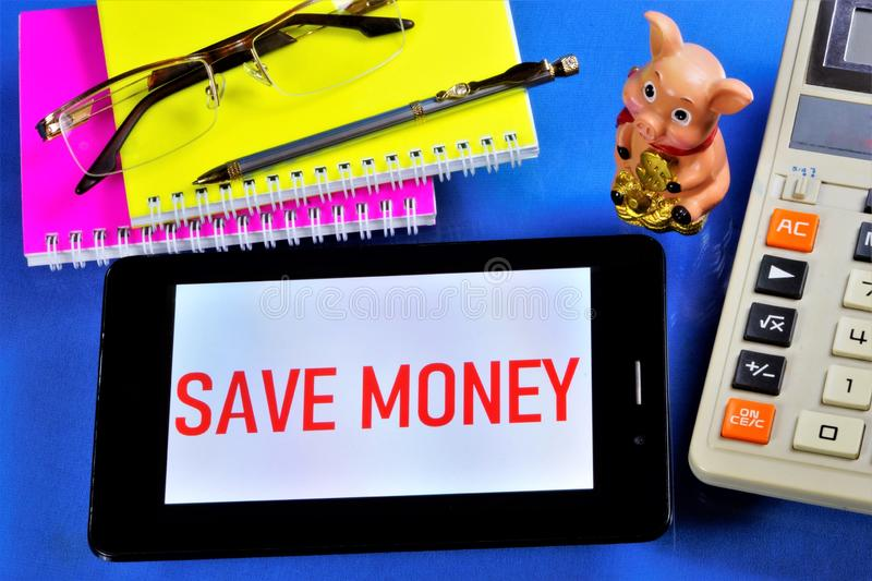 Save money-the message on the tablet PC.It is reasonable to seek benefits,effectively plan for the financial management,to avoid. Mindless spending,to direct royalty free stock photos