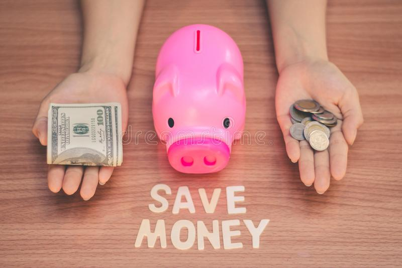 Save money in pig pink for future use. Save money in pig pink for future use, Concept saving money for the future royalty free stock photo