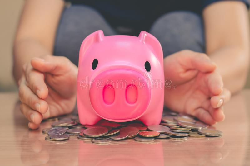 Save money in pig pink for future use. Save money in pig pink for future use, Concept saving money for the future stock photography