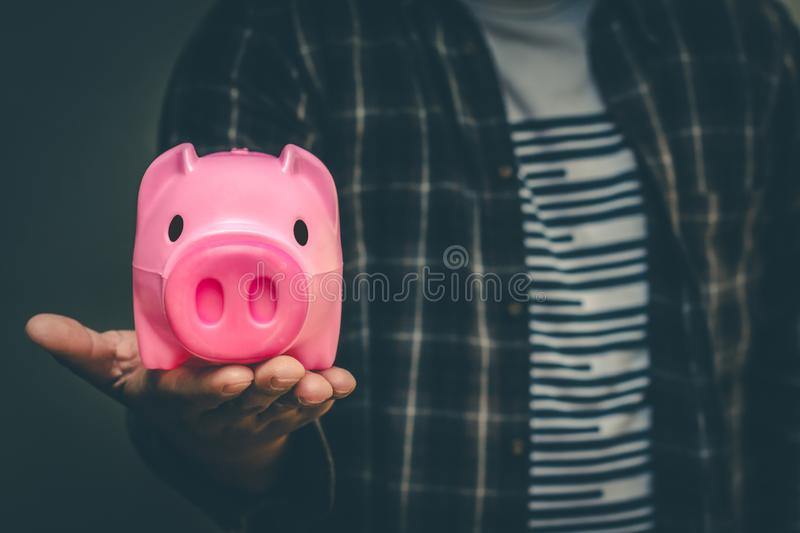 Save money in pig pink for future use, Concept saving money for the future.  stock photography