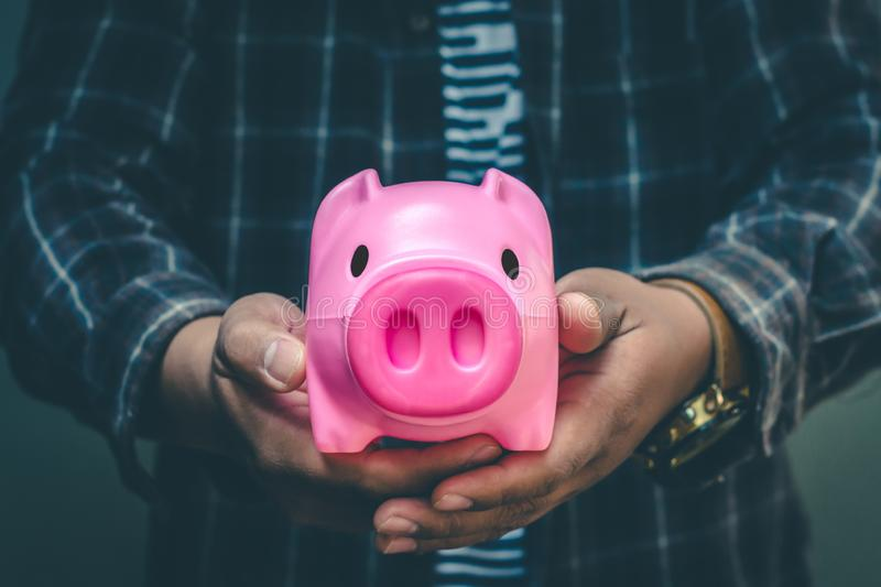Save money in pig pink for future use, Concept saving money for the future.  stock images