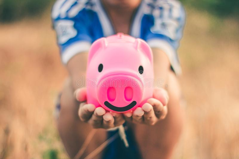 Save money in pig pink for future use, Concept saving money for the future.  stock image