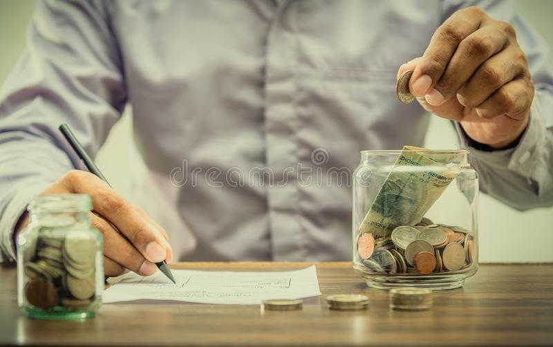 Save money for retirement for finance business concept. Save money for retirement and account banking for finance concept, Revenue and expeniture concept royalty free stock images