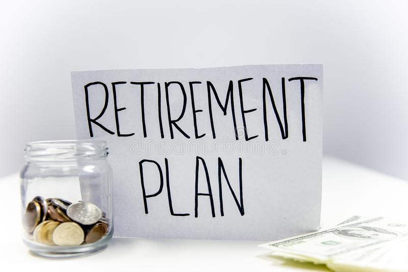 Retirement fund concept - money and a calculator royalty free stock image