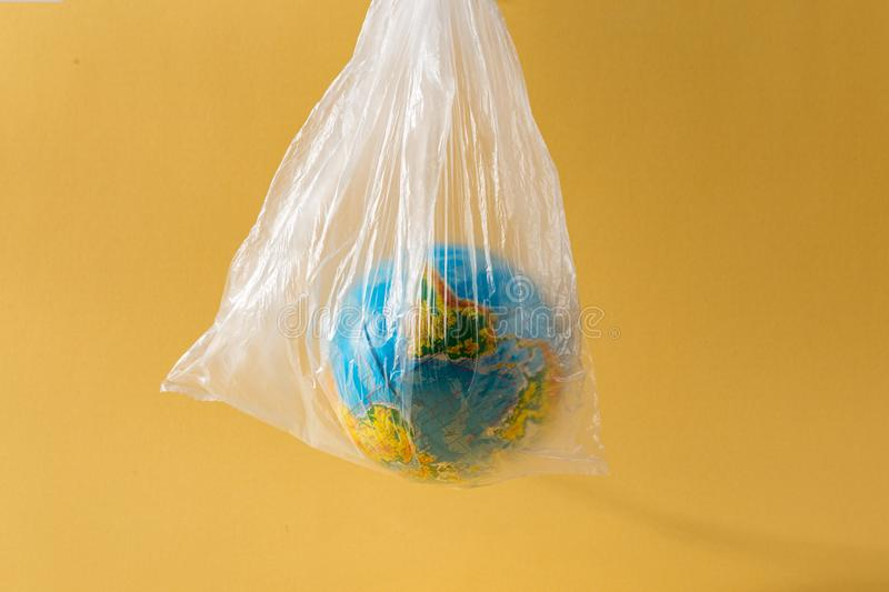 Save our planet or World Environment Day concept concept Earth plastic bag stock photos