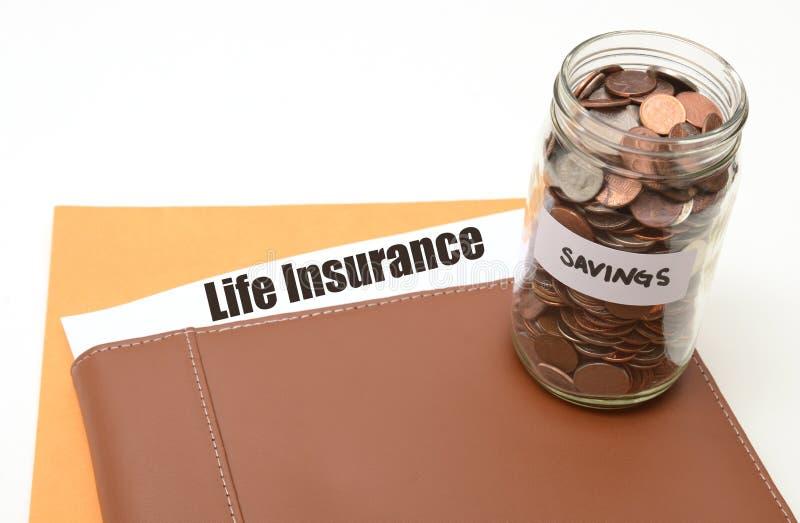 Save pieniądze na ubezpieczenie na życie fotografia stock
