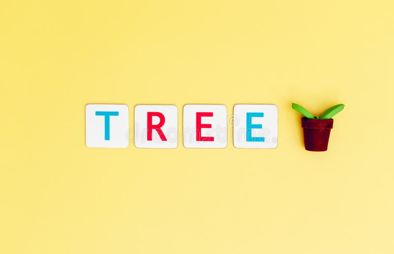 Save Tree with small plant tree for Ecology and Earth day concept. Save Tree Letter with small plant tree for Ecology and Earth day concept stock photo