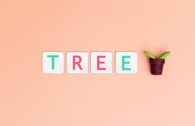 Save Tree Letter with plant tree for Ecology and Earth day concept. Save Tree Letter with small plant tree for Ecology and Earth day concept royalty free stock photography
