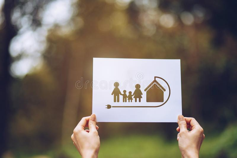 Save world ecology concept environmental conservation with hands holding cut out paper earth loving ecology family showing. Green, nature, tree, protection royalty free stock photo