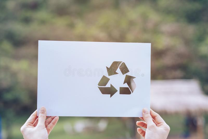 Save world ecology concept environmental conservation with hands holding cut out paper recycle showing. Nature, green, design, natural, background, creative royalty free stock photo