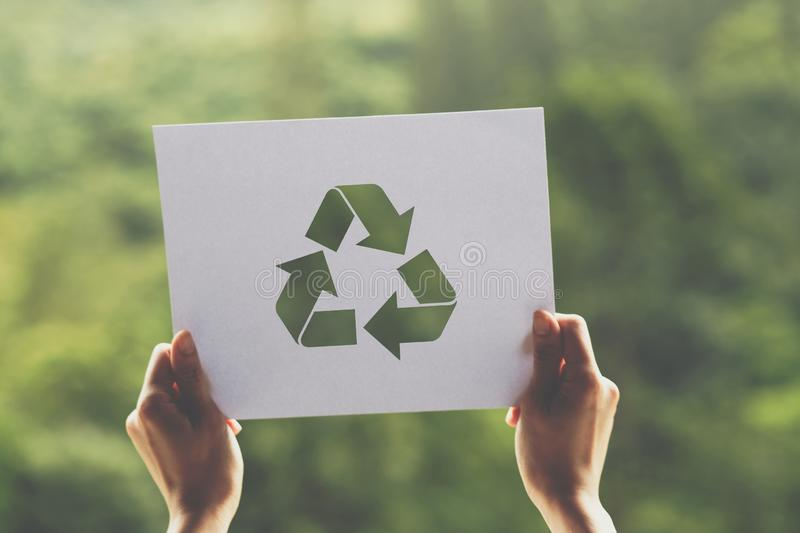 Save world ecology concept environmental conservation with hands holding cut out paper recycle showing. Nature, green, design, natural, background, creative royalty free stock image