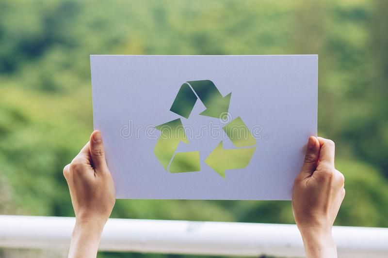 Save world ecology concept environmental conservation with hands holding cut out paper recycle showing. Nature, green, design, natural, background, creative stock images