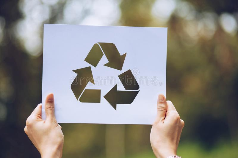 Save world ecology concept environmental conservation with hands holding cut out paper recycle showing. Nature, green, design, natural, background, creative stock image