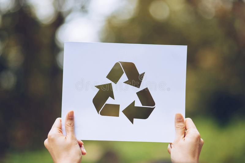 Save world ecology concept environmental conservation with hands holding cut out paper recycle showing. Nature, green, design, natural, background, creative royalty free stock images
