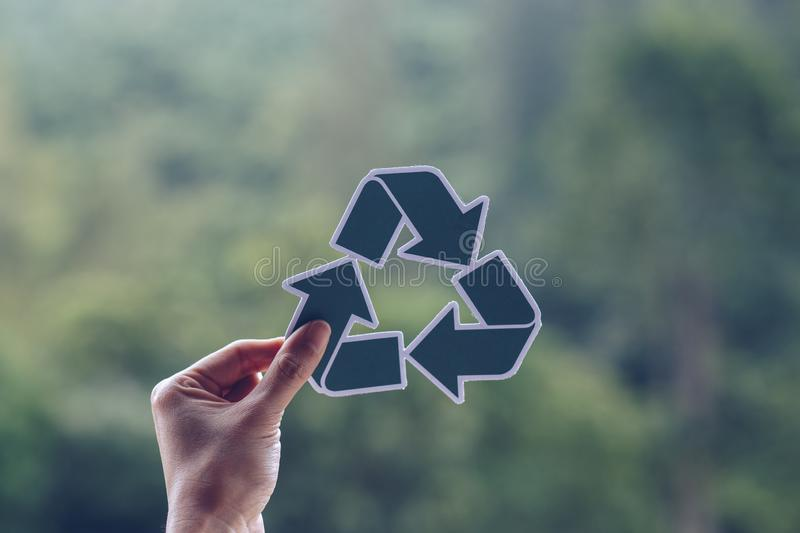 Save world ecology concept environmental conservation with hands holding cut out paper recycle showing. Nature, green, design, natural, background, creative stock photography