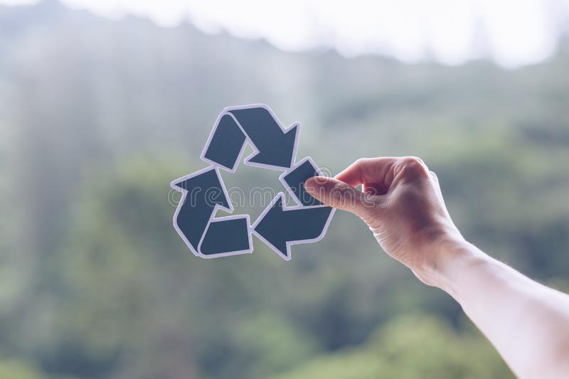Save world ecology concept environmental conservation with hands holding cut out paper recycle showing. Nature, green, design, natural, background, creative royalty free stock photography