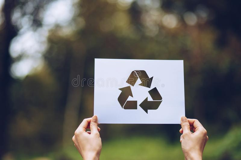 Save world ecology concept environmental conservation with hands holding cut out paper recycle showing. Nature, green, design, natural, background, creative stock photo