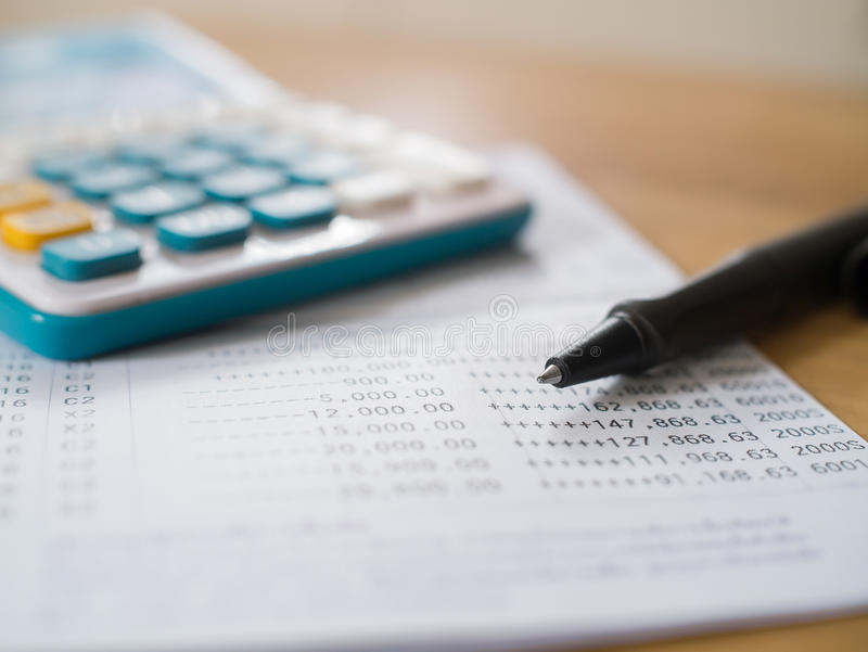 Saving Account Book From Bank With Pen And Calculator Stock Photo